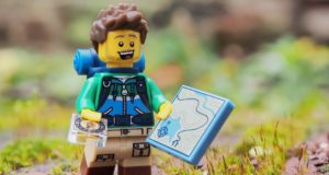 A Leggo hiker with a giant map